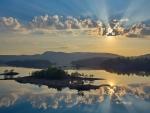 beautiful sunrays reflection on a lake