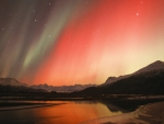 red aurora borealis over alaska