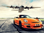 c-130 hercules over porsche 911 gt3 rs