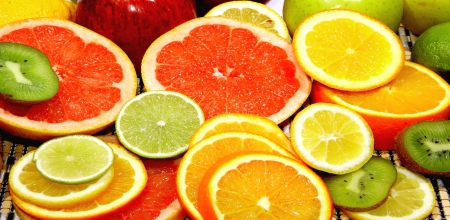 Slices of Citrus Fruits - apple, orange, kiwi, fruits, yellow, slices, abstract, lemon, oranges, lime, citrus, green, bunch, grapefruit, white