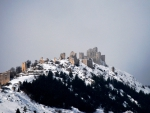 medieval castle ruins on a mountain in italy