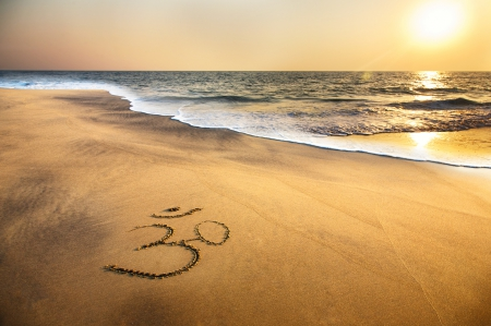 Om Symbol on the Beach - beach, brahma, sand, symbol, indian, ocean, om, sea
