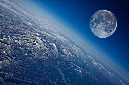 Moon above earth - both, atmosphere, mountains, surface