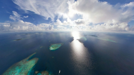 fantastic view of an ocean reef on a sunny day - view, ocean, ship, sunshine, clouds, reef, islands