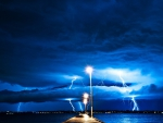 lightning storm from a pier at night