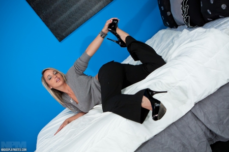 on the bed with nikki sims - babe, legs, heels, sexy, nikki