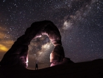 delicate natural arch under starry sky
