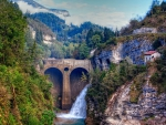 waterfall by a dam in a mountain gorge hdr
