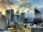 morning fog rising from a cityscape hdr