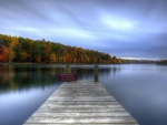 wooden dock on a calm lake hdr