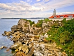 lighthouse on a rocky shore hdr