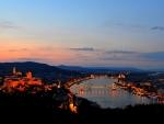 dawn over riverside castle
