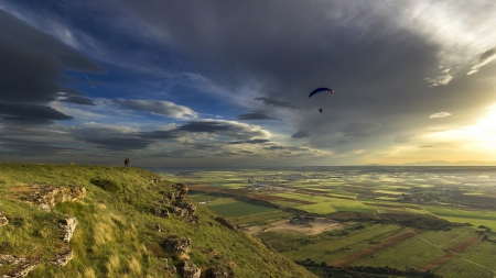 parachute skydiving into a beautiful valley - parachute, mountains, skydiving, sunset, clouds, valley