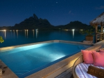 resort pool in bora bora at night