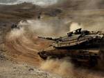 column of israeli merkava tanks in the desert