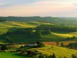 beautiful farm house amid fields on hills