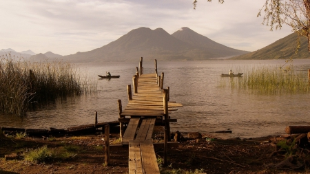 rickety pier on a lake in guatemala - mountain, boats, pier, rickety, lake