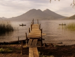 rickety pier on a lake in guatemala