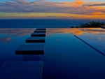infinity pool on oahu hawaii at sunset