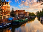 boats on a beautiful canal in amsterdam