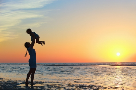 Mother And Child At Sunrise