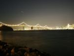 San Francisco Bay Bridge lit up at night