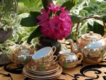 Flowers and Sets of Tea Pots