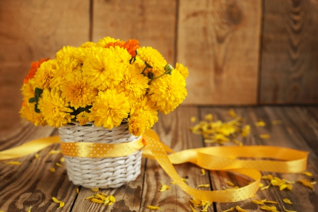 Beautiful Yellow Chrysanthemum's - table, wooden background, autumn, ribbon, yellow, still life, wicker basket, chrysanthemums, flowers