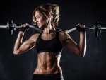 Brutal athletic woman pumping up muscles