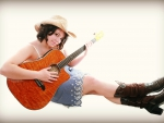 Cowgirl With Her Guitar