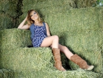 Cowgirl In The Hay