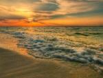 Sunset over Ocean Waves