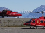 Helicopter and de Havilland Canada Dash 7 aircraft at Qaarsut Airport