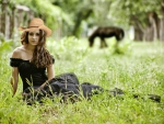 Cowgirl in a Field