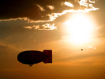 Blimp Silhouette and Hot Air Balloon
