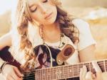 Beautiful girl playing a guitar