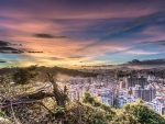 wondrous sunrise over city in a valley hdr
