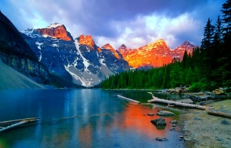 Moraine lake - hills, rocks, shore, beautiful, trees, sky, clouds, lake, mountain, tranquil, serenity, moraine, nature, reflection, landscape