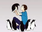 A Boy And His Penguins