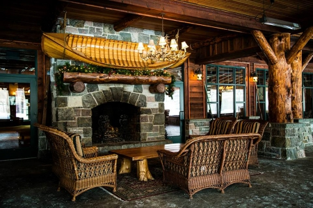 Whiteface Lodge - slate, cozy, living room, wicker, cabin, canoe, log, stone, fire place