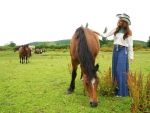 Cowgirl and Her Horses