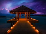 Lighted Pier in the Maldives under Purple Sky