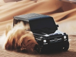 Mercedes G63 AMG playing in the sand