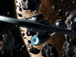 Starship Enterprise in an Asteroid Belt