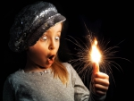 A small girl - sparklers