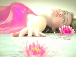 Girl between Lotus Flowers