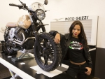 Moto Guzzi and brunette model
