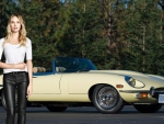Candice Swanepoel with a E Type Jaguar