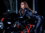 Amber Sym and motorcycle