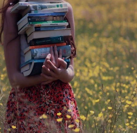 Girl carrying books - girl, books, time, summer, flowers, carrying, field